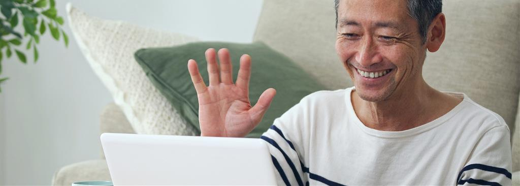 Man connecting with family online