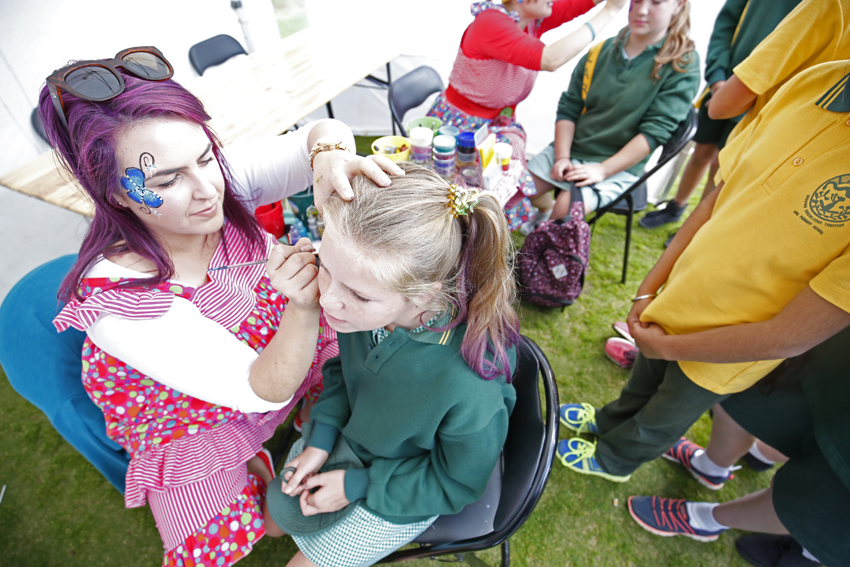 Face painting was popular with school students attending the Big Blue Bash.