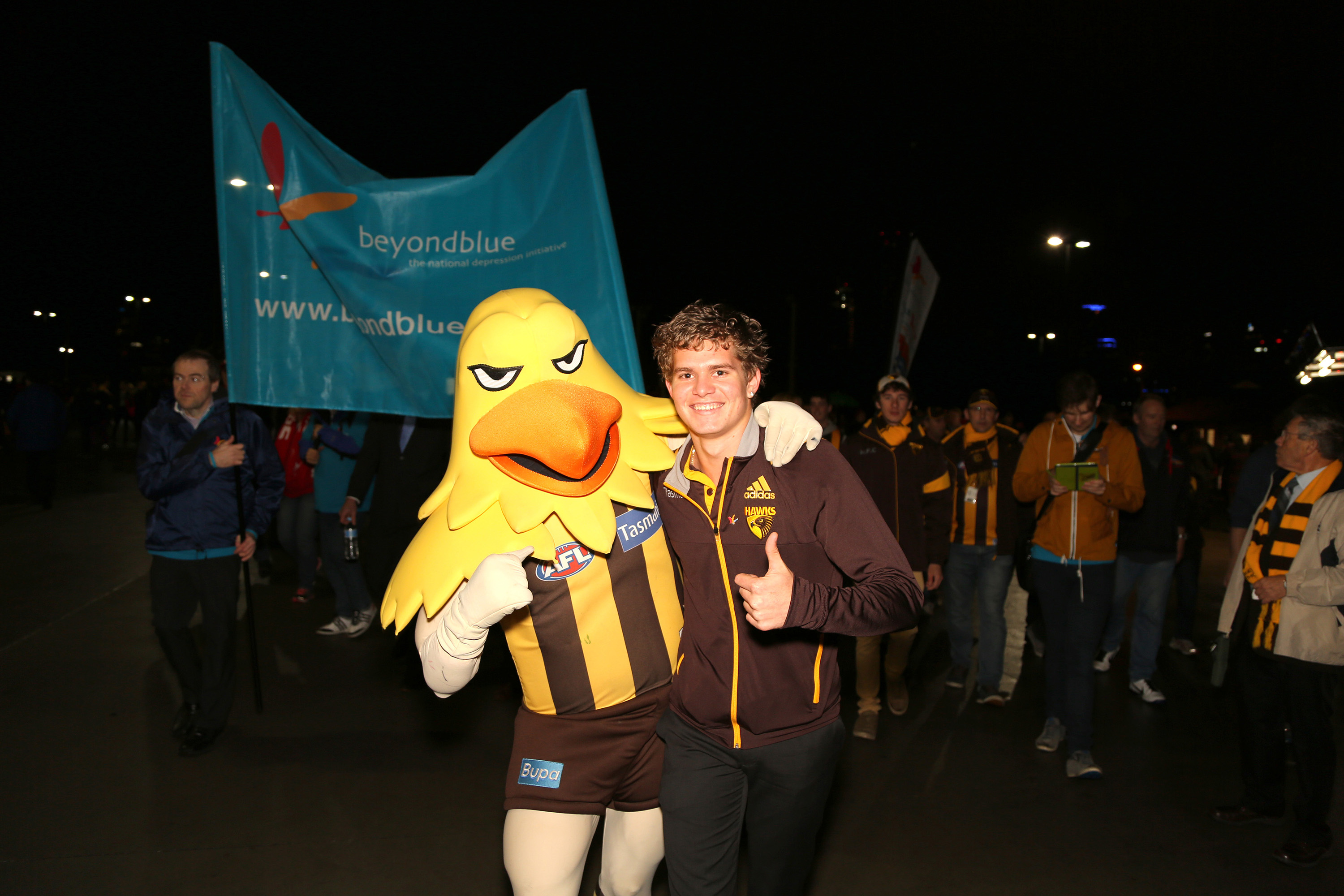 Hawks mascot 'Hawka' and player Jed Anderson help lead the March to the MCG before the AFLBeyond Blue Cup: VIC.