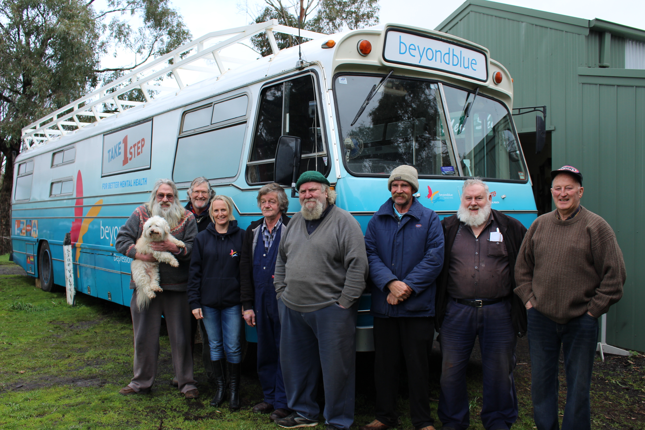Members of Cobaw Men's Shed in Kyneton with Beyond Blue's Athena and Roadshow Rhonda: VIC.