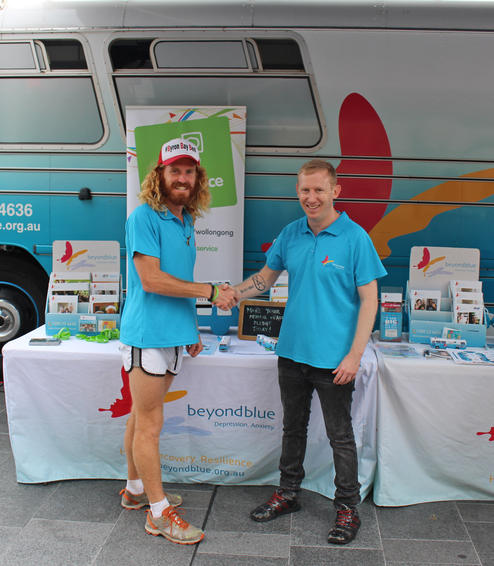 Byron Bay Ben - fresh from his 80km run from Sydney to Wollongong - greets Beyond Blue's Shaun at Crown Street Mall: NSW.