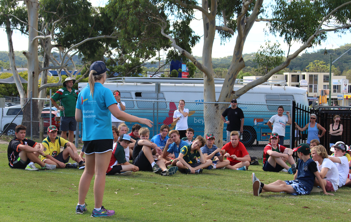 Beyond Blue's Bron talks good mental health to youngsters before a free cricket clinic in Erina.