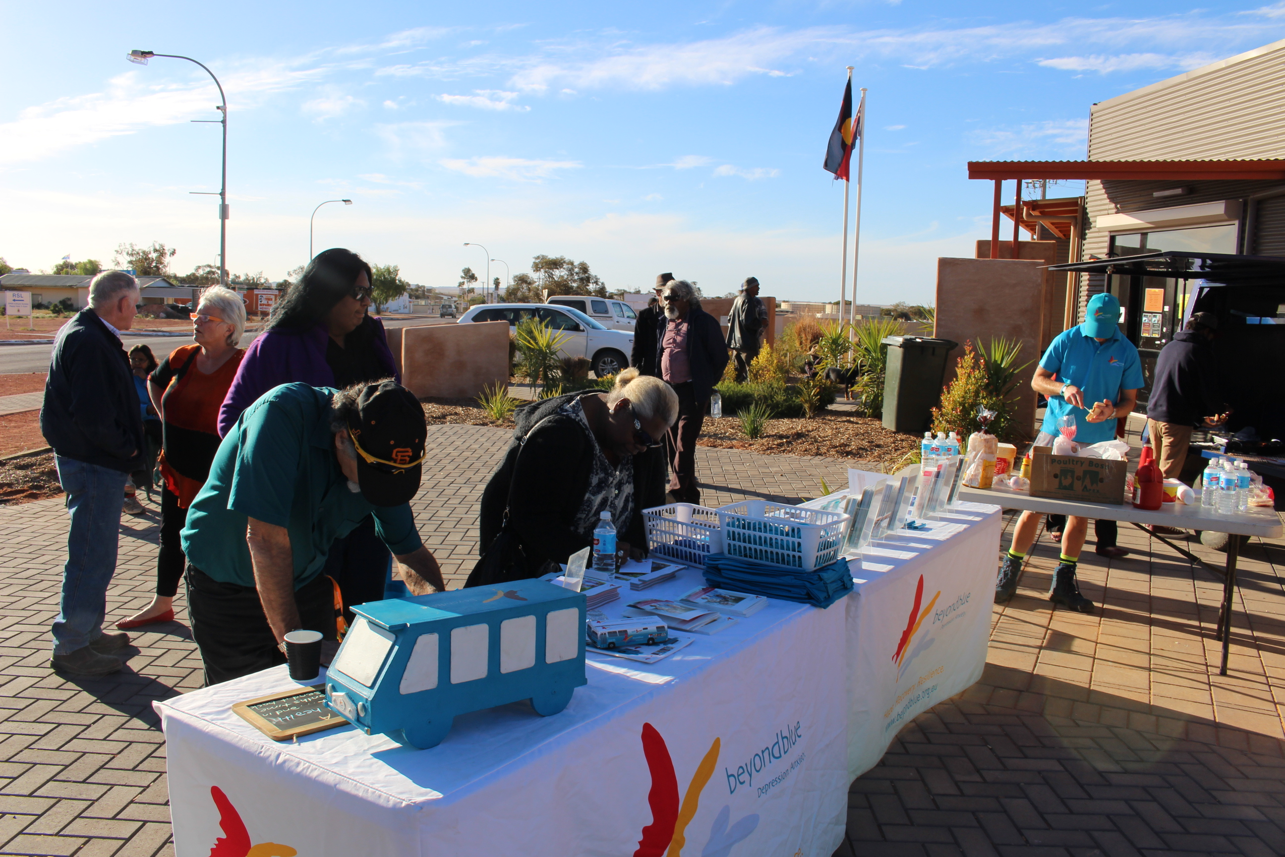 Providing resources and a free barbecue at Umoona Tjutagku Health Service Aboriginal Corporation Mens Shed in Coober Pedy.