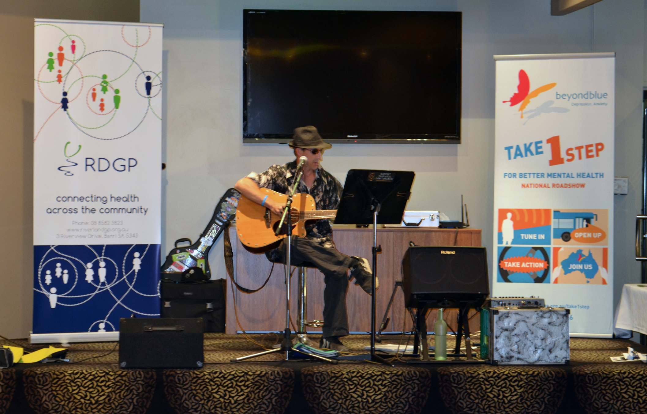 Musician Harrison Lowe performs at the Growers' Night Off.