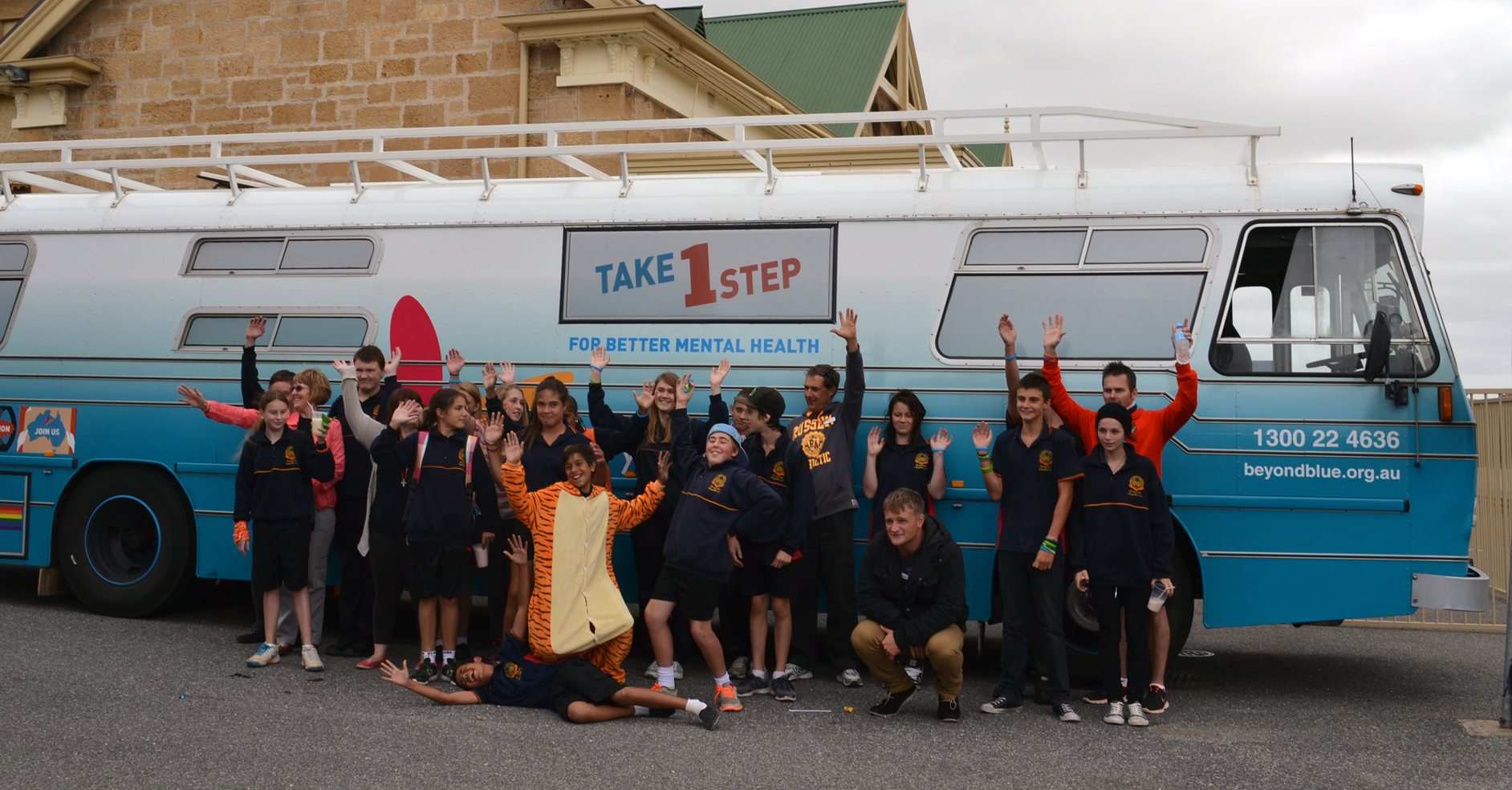 A school group in Murray Bridge greets the bus.
