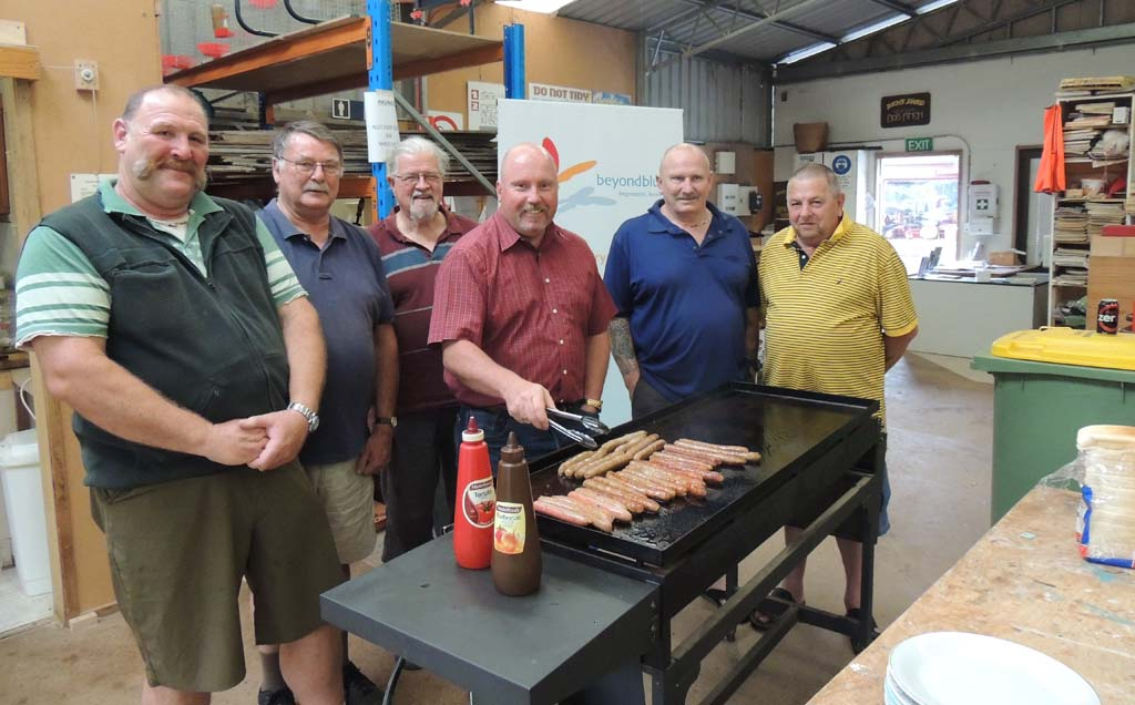Beyond Blue Ambassador Paul Walshe with members of Ben's Shed
