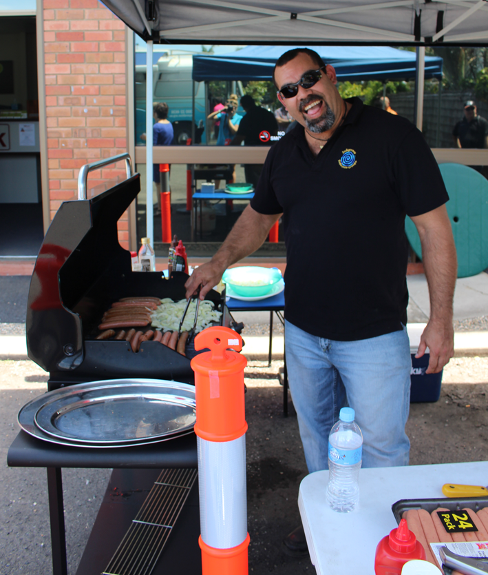 Firing up the barbecue outside the Worklink office in Cairns.
