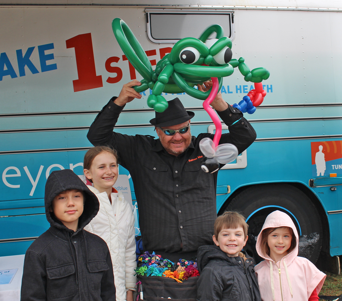 Balloon Master Brendan sculpts a friendly frog at Red Hill Community Market.