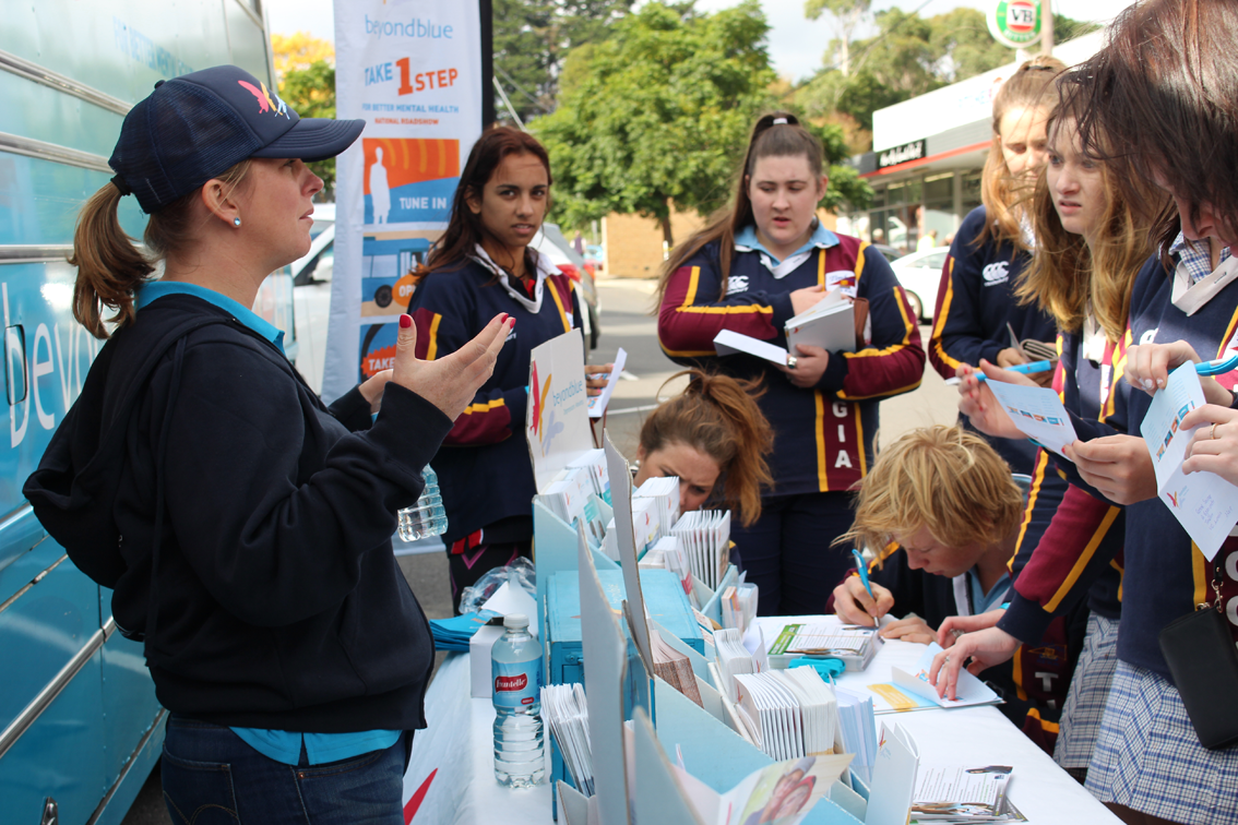Beyond Blue's Patrice chatting to students in Timboon's main street.