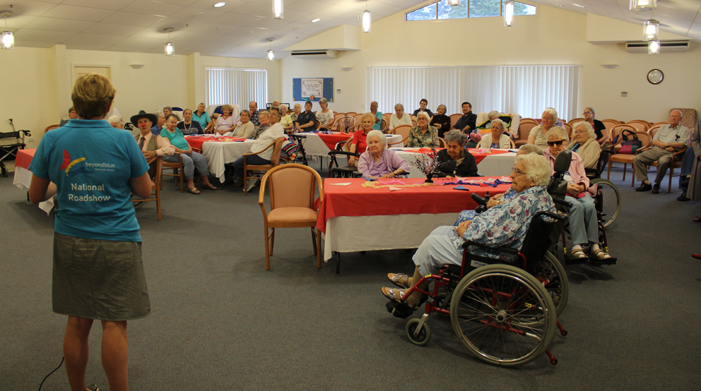 Talking to residents at St Paul de Chartres aged care facility.