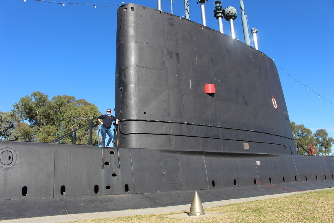 Admiring the size of Holbrook's famous submarine, the HMAS Otway.