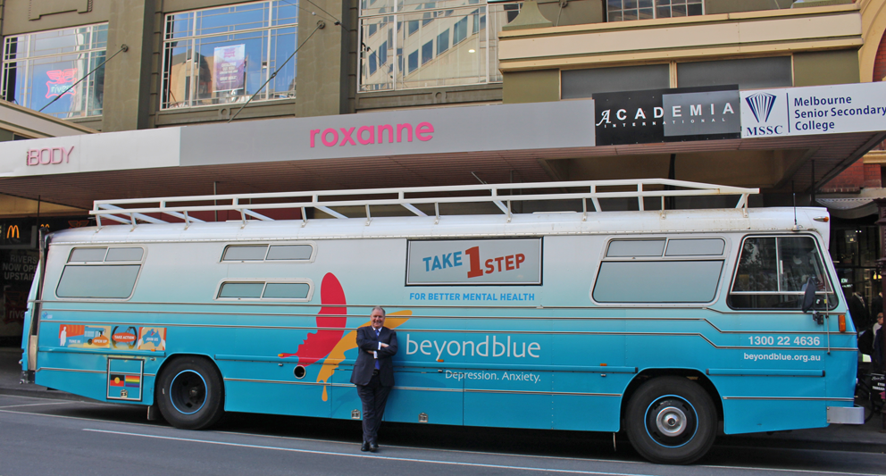 Lord Mayor Robert Doyle with the big blue bus.