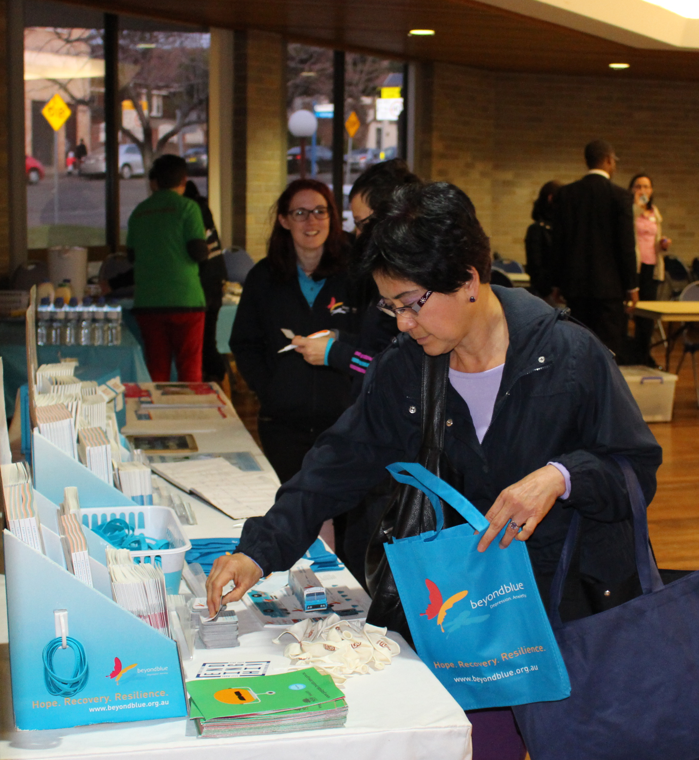 Checking out resources at the multicultural health expo at Lakemba Senior Citizen's Centre.