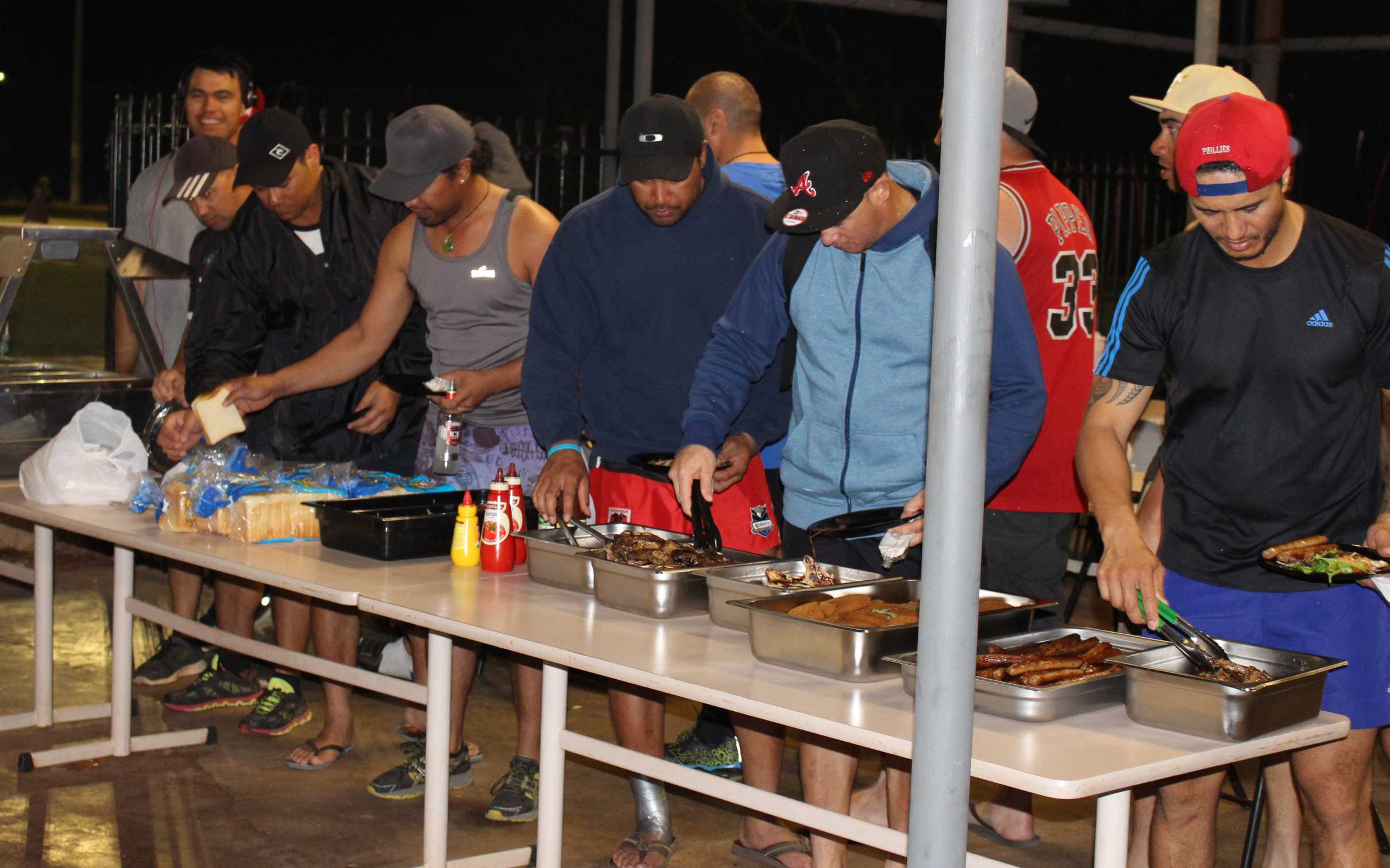 Plating up at Onslow Sports Club for the community barbecue.