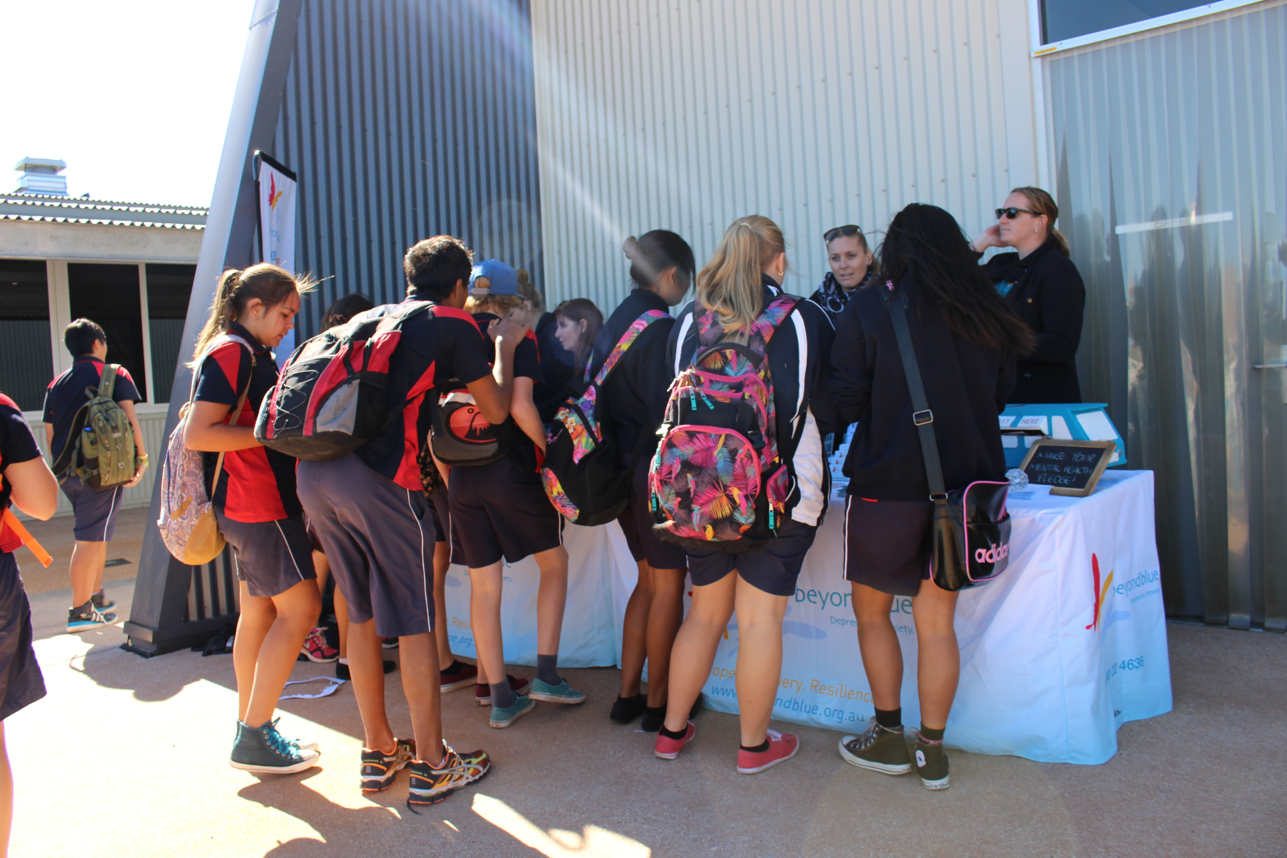 Students in Karratha pick up free Beyond Blue info.