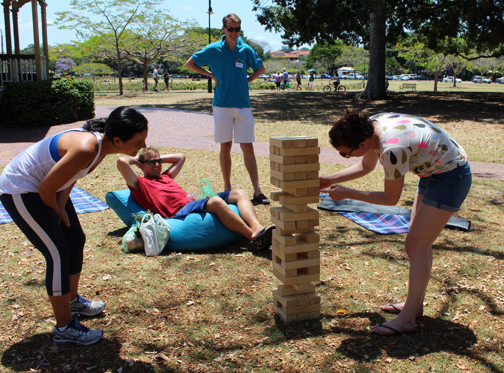 Playing giant jenga in New Farm Park.