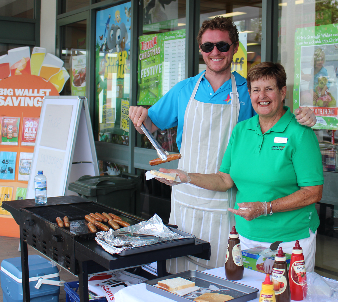 Cooking up the free community barbecue in Moree.
