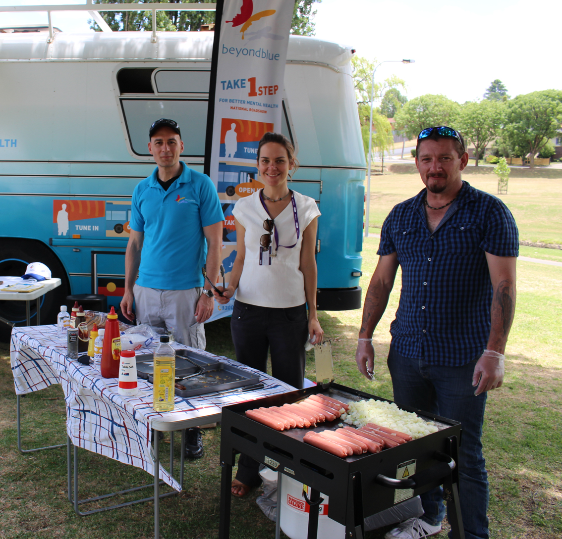Cooking up the free community barbecue at Curtis Park in Armidale.