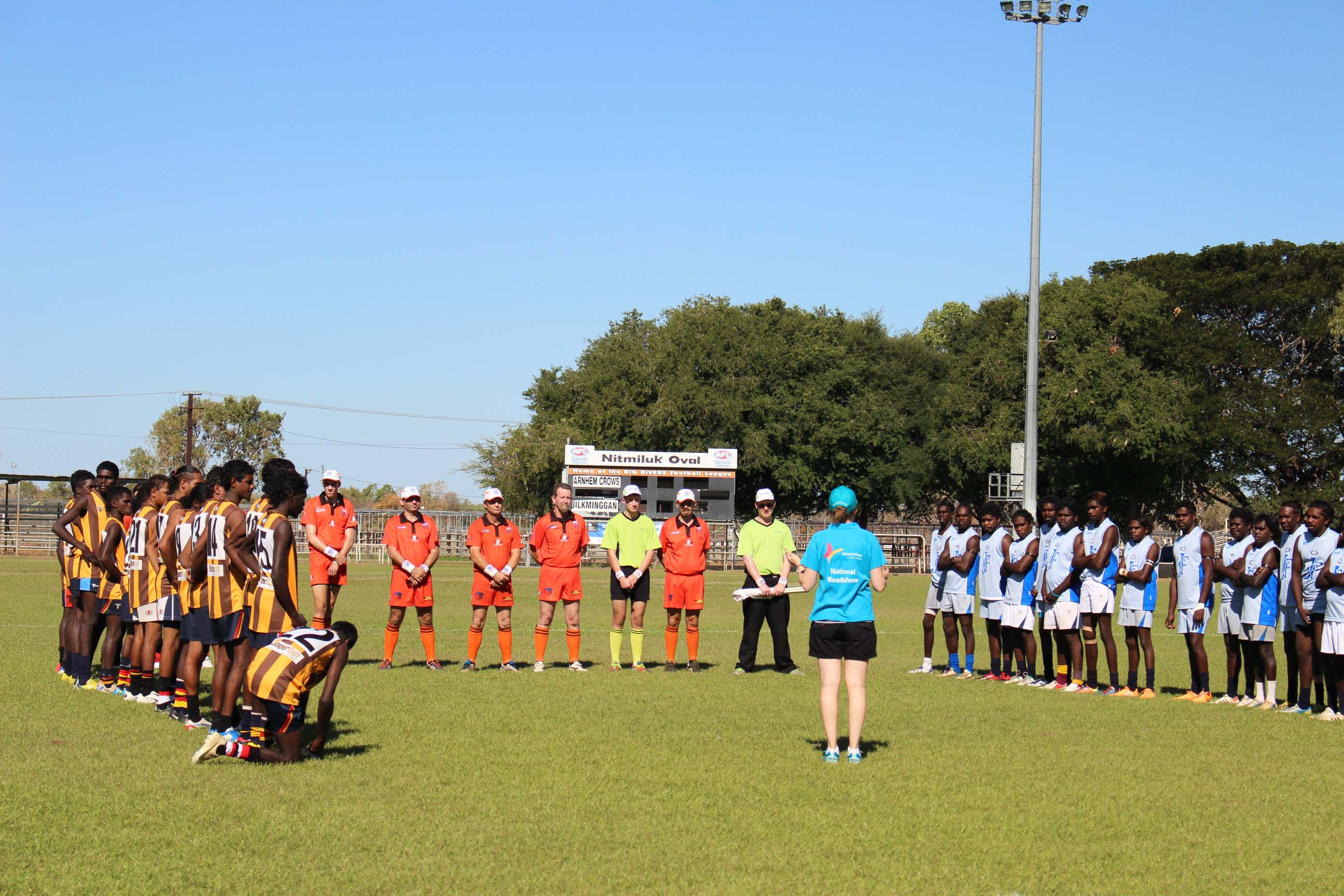 Beyond Blue's Katie speaks to teams ahead of one of the football matches in Katherine.