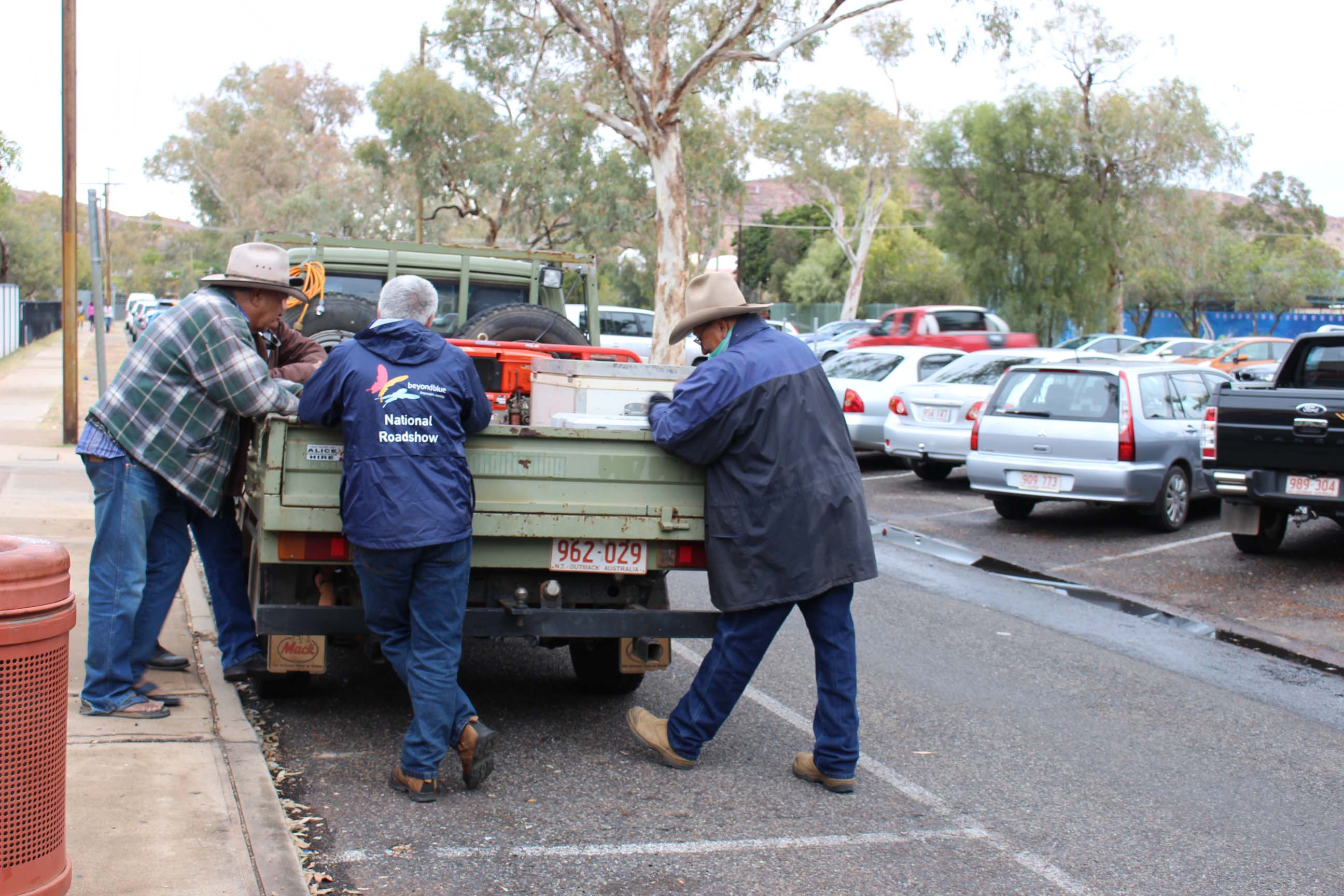 Yarning around a ute in Alice Springs.