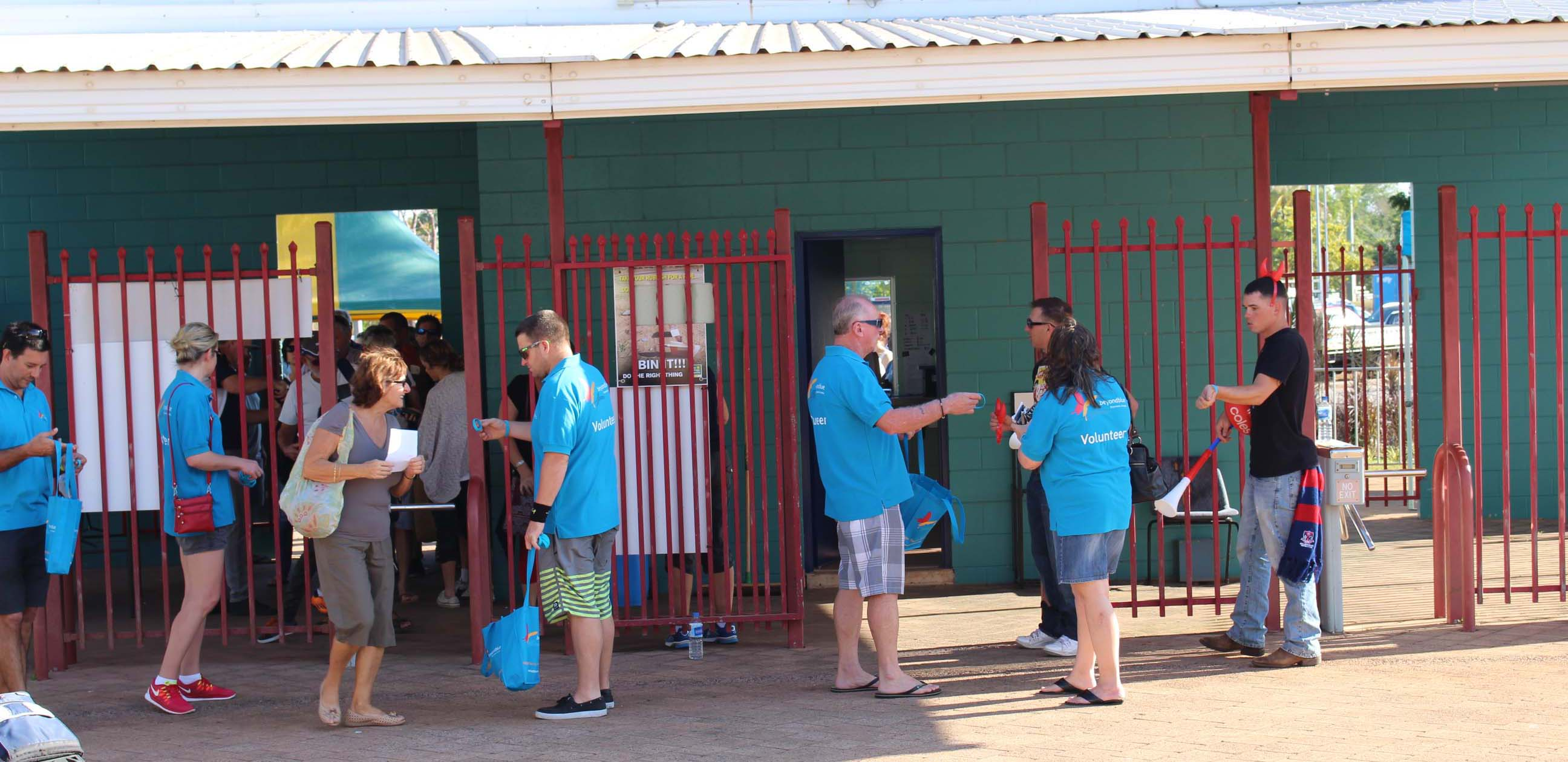 Beyond Blue volunteers handed out wristbands ahead of the NEAFL and AFL clashes at TIO Stadium in Darwin.