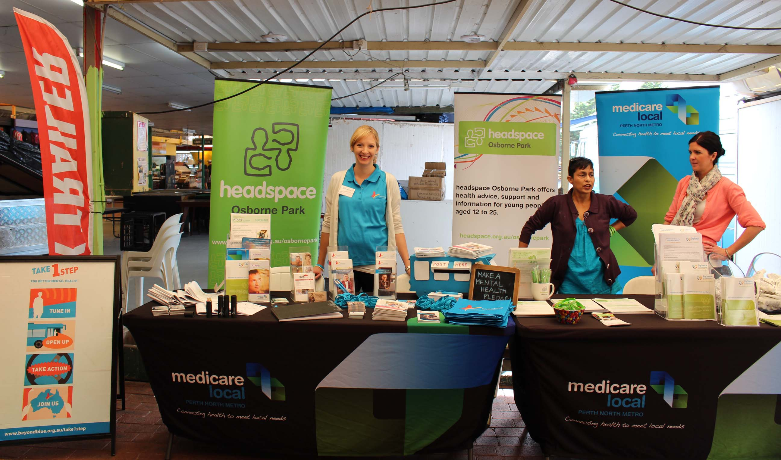 Beyond Blue's Tiff with resources at the Wanneroo Markets in Wangara.