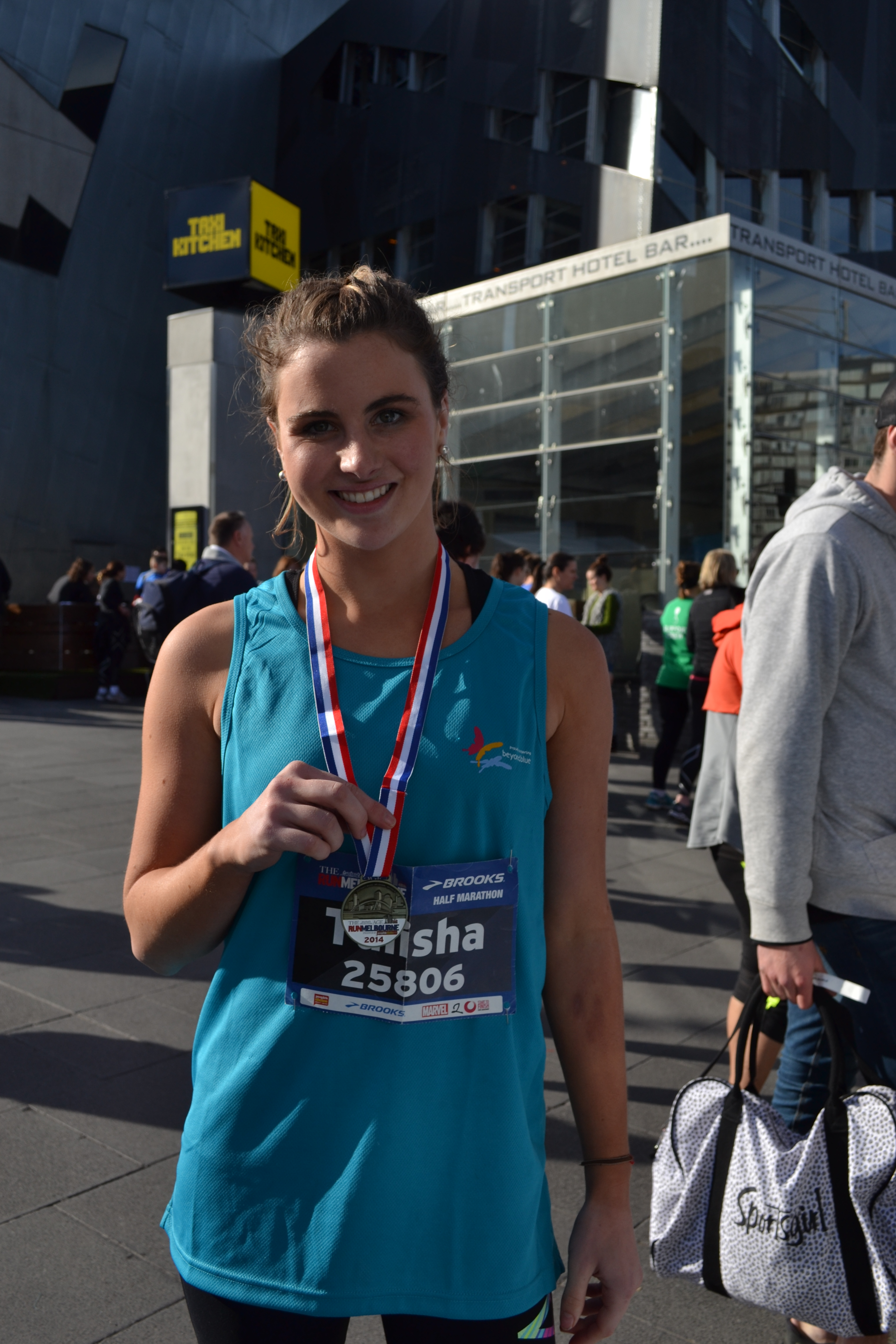 Another Beyond Blue supporter shows off her Run Melbourne medal.