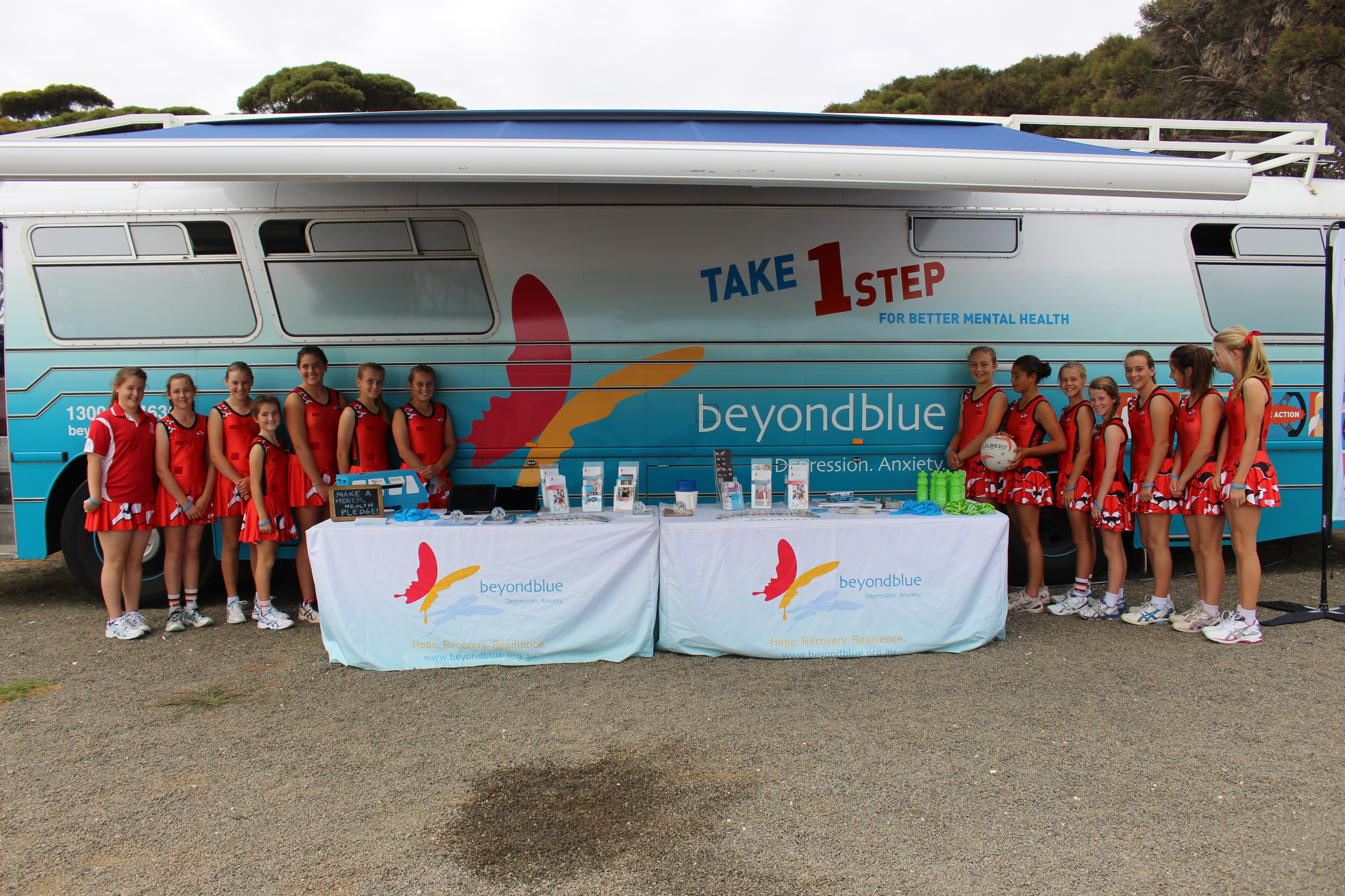 Junior netballers inspect the bus.