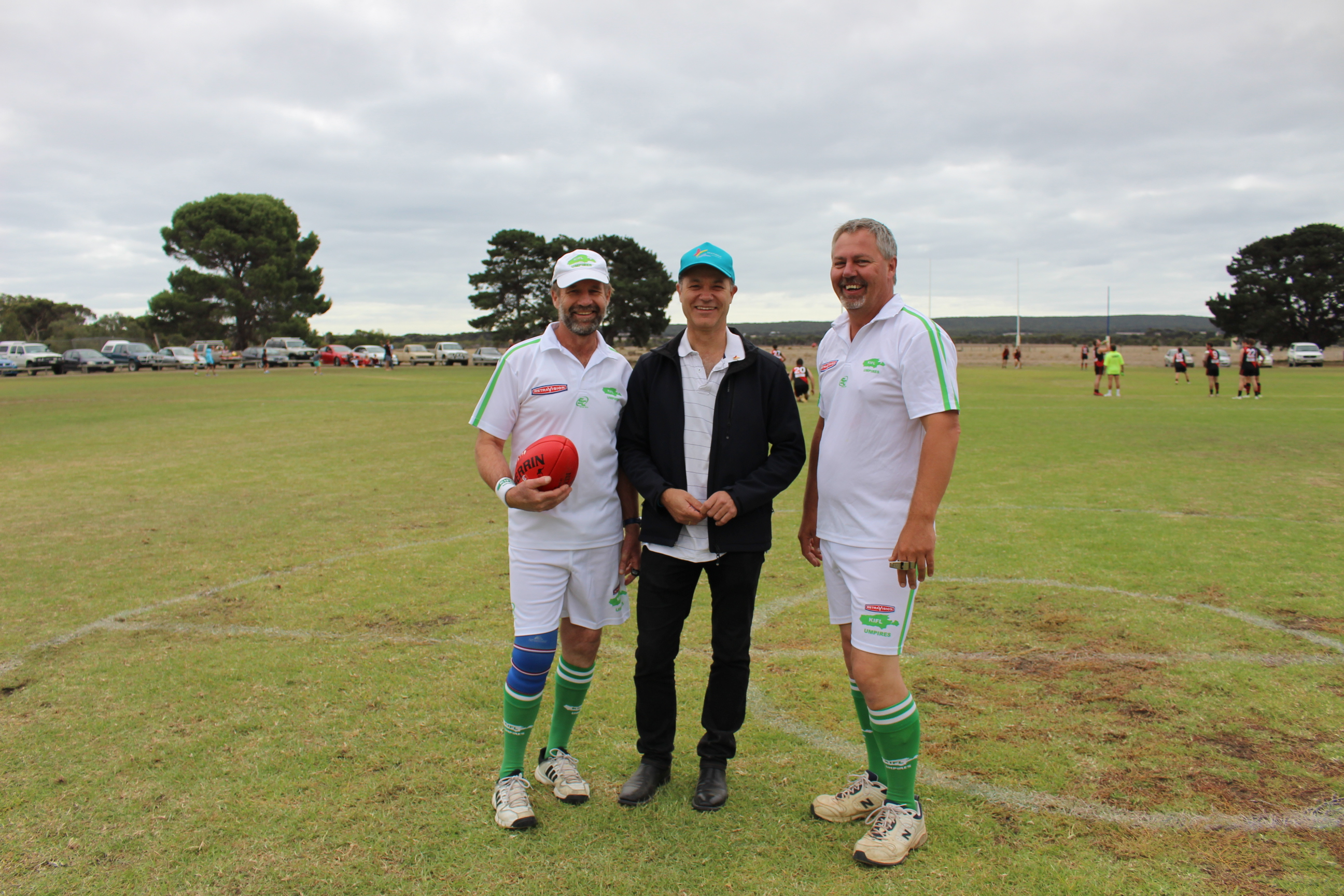 Beyond Blue Board Director Associate Professor Michael Baigent with KIFL umpires.