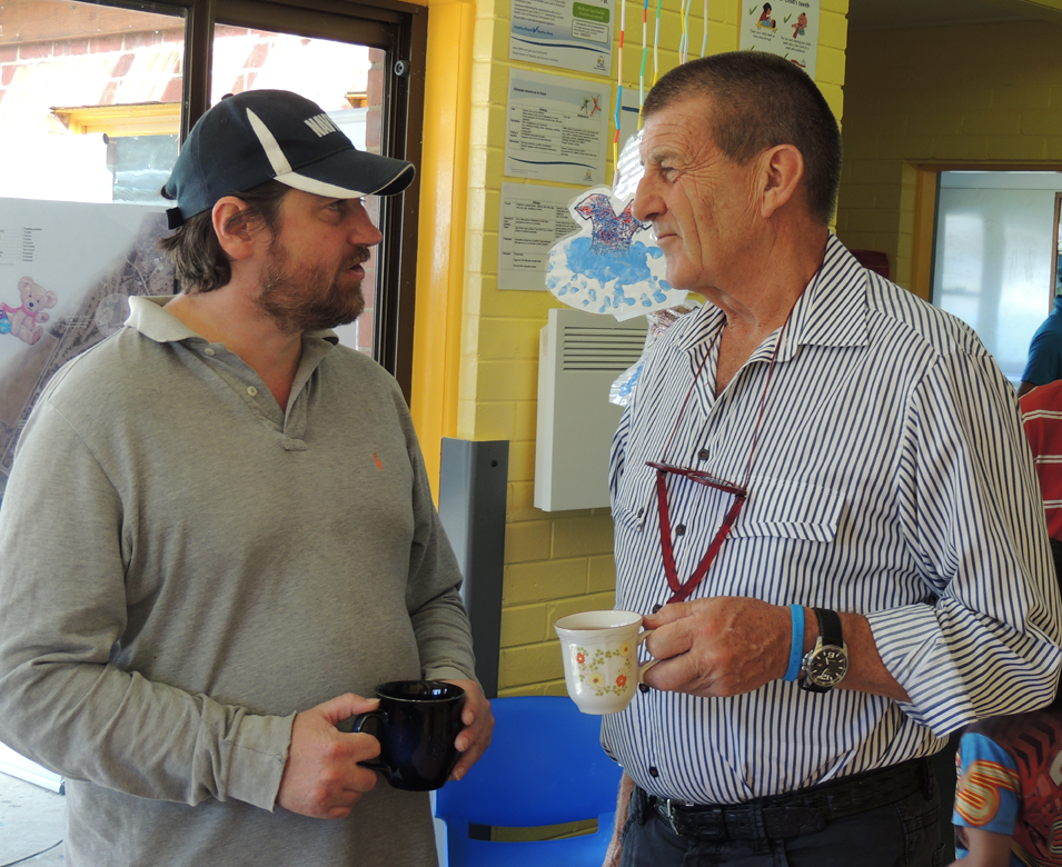 A local chats with Beyond Blue Chairman Jeff Kennett in Dunalley.