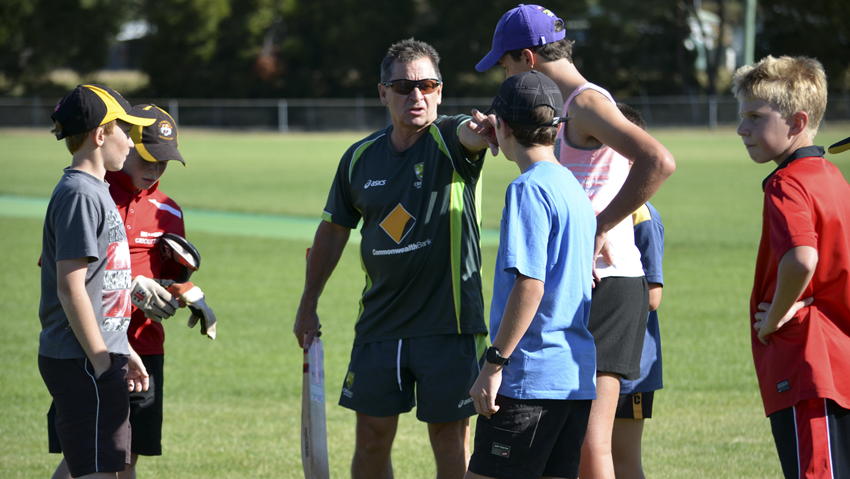 Former Tassie Tigers coach Tim Coyle gives direction at the Longford cricket clinic. Photo courtesy of Corey Martin, The Examiner.