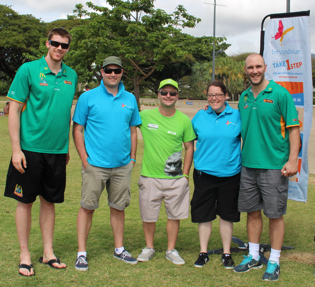 Townsville Crocodiles' Brian Conklin (far left) and Steven Markovic (far right) stopped by to say g'day at the free community barbecue at the Riverway Precinct in Townsville.
