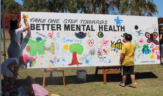 A colourful community art canvas underway in Bundaberg.