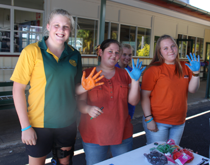 Hands up! Students at Burnett State College added their hand prints to a colourful art canvas project.