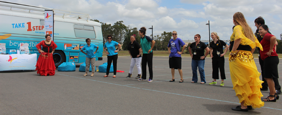 Getting a dance lesson from the Nefertiti Middle Eastern Dance Group at USQ's Mental Health Week Expo in Hervey Bay.