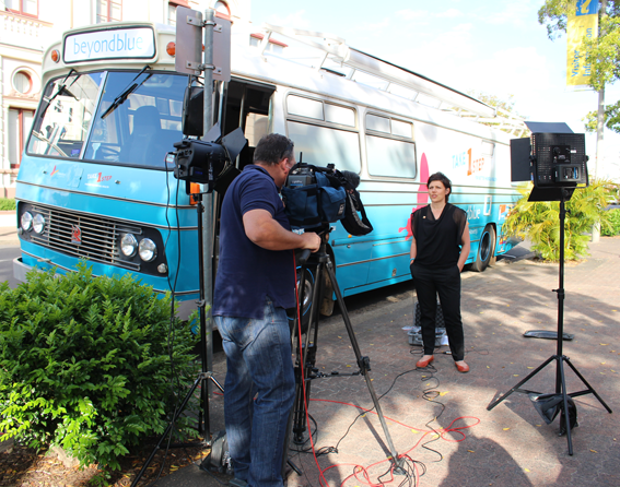 Beyond Blue CEO Georgie Harman is interviewed outside Maryborough's City Hall by Channel Ten's The Project.