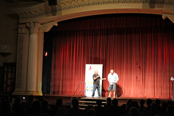 Comedian Kevin Kropinyeri gets an audience member involved in the free comedy night in Maryborough.