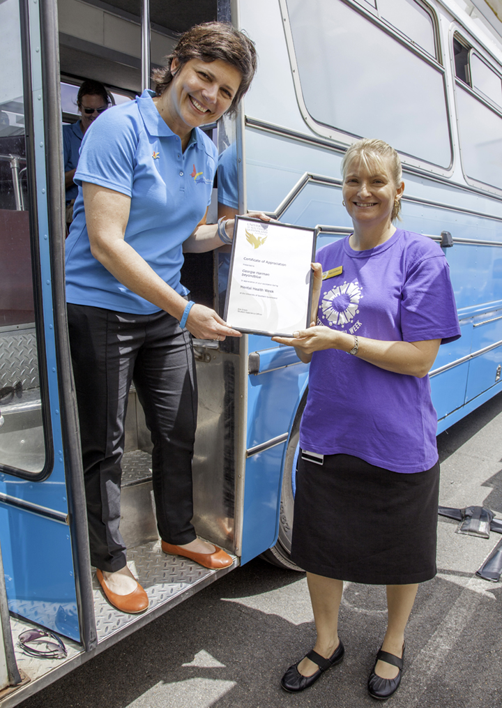 Beyond Blue CEO Georgie Harman accepts a certificate of thanks from USQ counsellor Kathy Cool-Murphy.