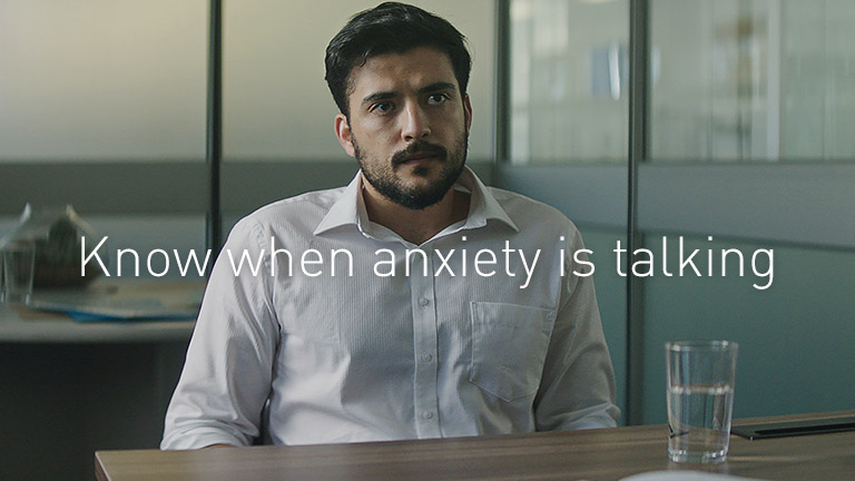 Man with anxiety at work